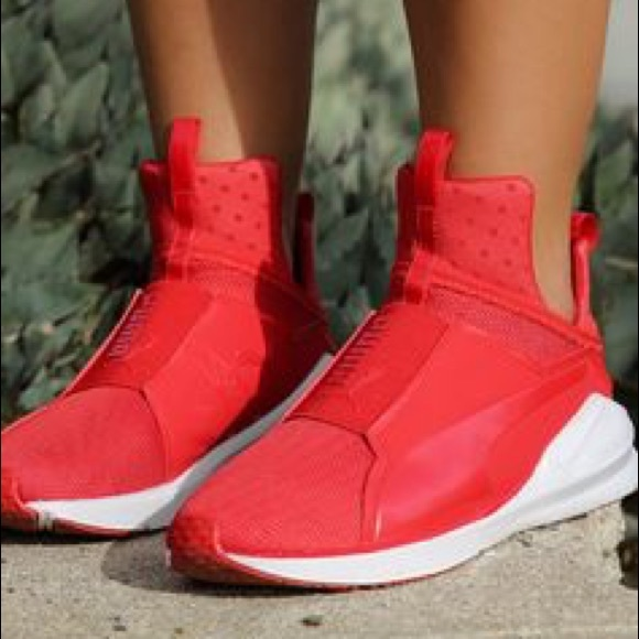 Red Fierce Pumas with white bottoms. M 5a98a2362c705dc8e2526f94 06cc52c92